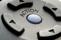 Action Button. On television remote control Royalty Free Stock Photos