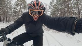 Action cam on frame installed behind. Close-up pov view. Professional extreme sportsman biker riding fat bike in outdoor