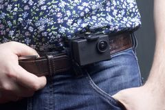 The action camera is fixed to the waist belt of a man. The action camera is fixed to the waist belt of a man Royalty Free Stock Images
