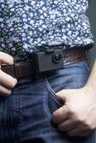 The action camera is fixed to the waist belt of a man. The action camera is fixed to the waist belt of a man Stock Image