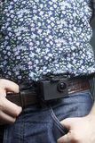 The action camera is fixed to the waist belt of a man. The action camera is fixed to the waist belt of a man stock photo