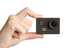 Action camera in hand. Royalty Free Stock Images