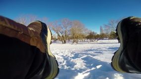 Action camera on the kid sled board stock footage