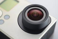 Action camera lens close-up. Lens of camera for recording actions. Macro close-up shot royalty free stock photography