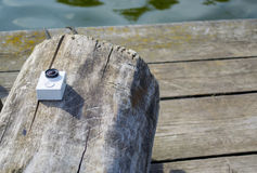 Action camera on a log Royalty Free Stock Photo