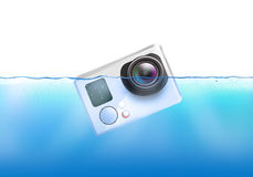 Action camera sinks in water. Stock Photos