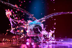 Action camera splashed with water Royalty Free Stock Image
