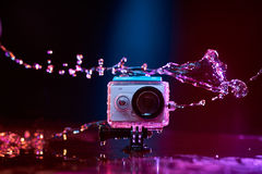 Action camera splashed with water Royalty Free Stock Photo