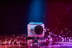 Action camera splashed with water Royalty Free Stock Photos
