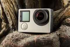 Action Camera. Sports action camera on stone background royalty free stock photography