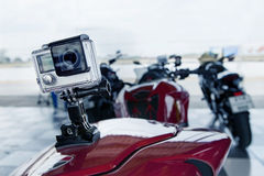 Action camera spot mounted on rear of sport motorcycle Stock Photography