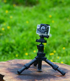 Action camera on tripod in grass area Royalty Free Stock Photos
