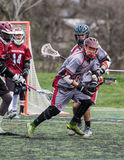 Action in Close. Redding, California: Lacrosse players from Woodcreek and Chico mix it up on the field in a tournament game at the 2016 Lacrosse Jamboree in stock image
