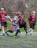 Action in Close. Redding, California: Lacrosse players from Woodcreek and Chico mix it up on the field in a tournament game at the 2016 Lacrosse Jamboree in royalty free stock image