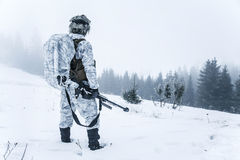 Action in cold conditions sniper with weapons. Winter arctic mountains warfare. Action in cold conditions. Sniper with weapons Stock Photo