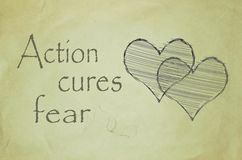 Action cures fear message written on old paper Stock Photography