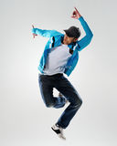 Action dance movement. Dancer jumps into the air and holds a pose, motion, movement and emotion all captured in this image Royalty Free Stock Photography