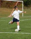 Action de l'adolescence 20 du football de la jeunesse photo libre de droits