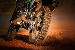 Action of enduro motorcycle on dirt track Stock Image