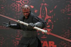 Action figure model Darth Maul holding double-bladed lightsaber, Character from Star Wars movie