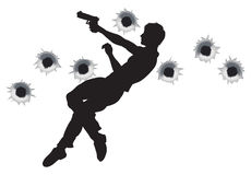 Action hero in gun fight silhouette. Action hero leaping through the air and shooting in film style gun fight action sequence. With bullet holes Royalty Free Stock Image