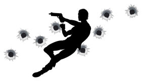 Action hero in gun fight silhouette. Action hero leaping through the air and shooting in film style gun fight action sequence. With bullet holes Royalty Free Stock Photo