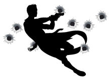 Action hero in gun fight silhouette. Action hero leaping through the air and shooting in film style gun fight action sequence. With bullet holes Stock Photo