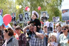The action Immortal regiment on Victory parade. Stock Photos