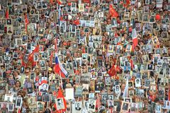 The action `Immortal regiment` during the Victory parade. Moscow, Russia. The action `Immortal regiment` during the Victory parade on May 9, 2016: people holding Stock Images
