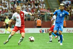 In action Kamil Glik L and Yonatan Cohen. WARSAW, POLAND - JUNE 10, 2019: Qualifications Euro 2020  match Poland - Israel 4:0. In action Kamil Glik L and Yonatan stock photography