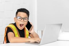 Action Kid engineer shocked to hear something for the phone stock photography