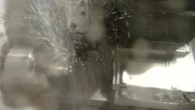 Action of lathe machine. Splashes of liquid. Water as a coolant stock video footage
