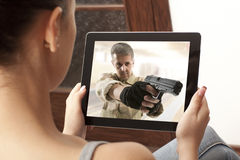 Action movie on tablet. Cropped image of women looking at action movie on tablet stock photos
