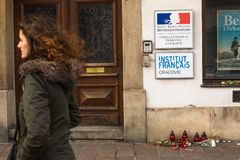Action near the facade of the Consulate General of France in Krakow solidarity for the victims of the Charlie Hebdo attacks in Par Royalty Free Stock Image