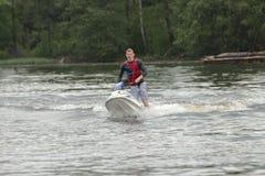 Action Photo Man on jet ski. Royalty Free Stock Photography