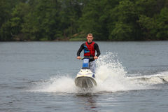 Action Photo Man on jet ski. Royalty Free Stock Image