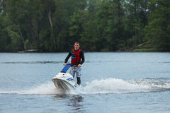 Action Photo Man on jet ski. Royalty Free Stock Image