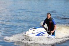 Action Photo Man on jet ski. Royalty Free Stock Photo