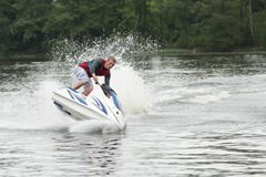 Action Photo Man on seadoo. Jet Ski Tricks. Royalty Free Stock Image