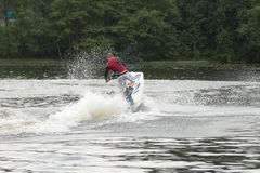 Action Photo Man on seadoo. A view from the back. Royalty Free Stock Images