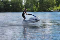Action Photo young woman on jet ski. Stock Photo