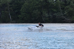 Action Photo young woman on jet ski. Royalty Free Stock Photography