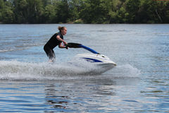 Action Photo young woman on jet ski. Royalty Free Stock Images