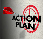 Action Plan Arrow Hitting Target Aim Focus Goal Objective. Action Plan words on a bull's eye or target and arrow hitting to illustrate meeting a goal or Royalty Free Stock Images