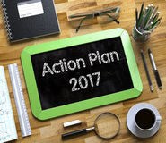 Action Plan 2017 Handwritten on Small Chalkboard. 3D. Top View of Office Desk with Stationery and Green Small Chalkboard with Business Concept - Action Plan vector illustration