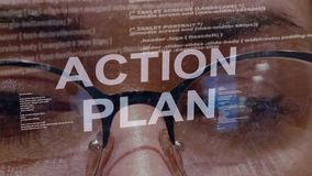 Action plan text on background of female developer. Action plan text on the background of female software developer. Eyes of woman with glasses are looking at stock video footage