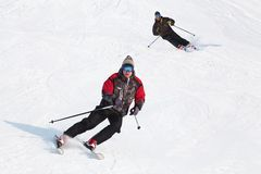 Action in powder snow. Male skier turning in deep powder with mountains valley's Stock Images