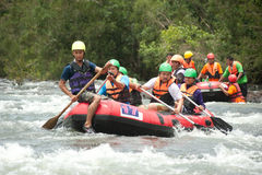 Action at rafting racing in Thailand. Royalty Free Stock Photography