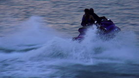 Action ride on a jetski in the evening USA cityscapes stock footage