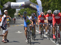 Action scene during the race, with a cyclist asking for water, during Road Grand Prix event, a high-speed circuit race Stock Image